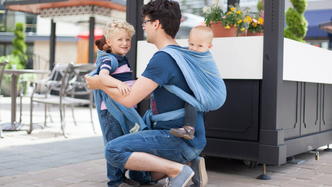 Dad with baby and toddler babywearing